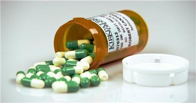 医学配方绿白色胶囊咖啡色处方瓶延时镜头高清视频实拍