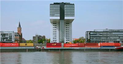 德国科隆莱茵河畔大型载货货柜轮船行驶运动镜头高清视频实拍